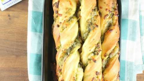 Cheesy Pesto Breadsticks are the perfect side for any meal. Packed with ooey gooey mozzarella cheese and tons of flavor from the sweet basil pesto. Made with Red Star Yeast. Recipe from missinthekitchen.com #ad
