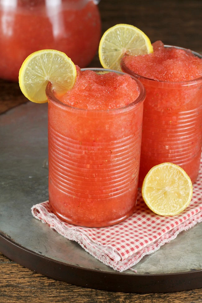 Strawberry Lemonade Moscato Slushie Cocktail garnished with Lemon Slices