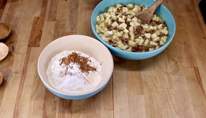 bowl with flour, cinnamon + bowl of chopped apples and pecans