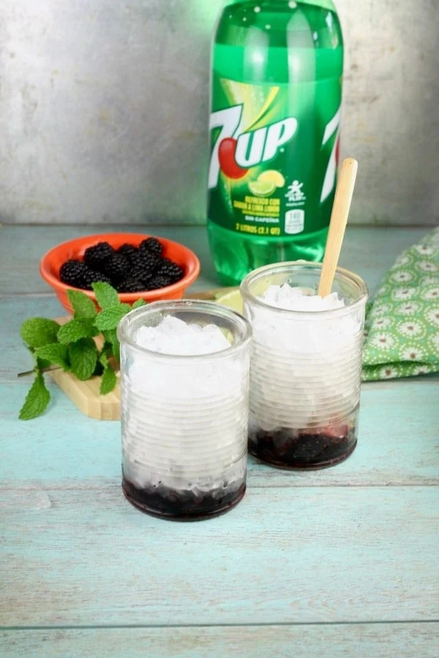 Adding ice to Easy Blackberry Mojitos Recipe made so simply with 7UP! Get the recipe and more at MissintheKitchen.com #ad #MixItUpALittle