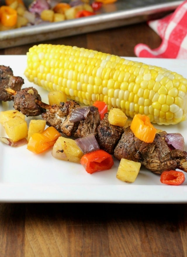 Balsamic Pork Skewers with Pineapple, Sweet Peppers and Onions grilled to perfection for the best summer meal! From MissintheKitchen.com