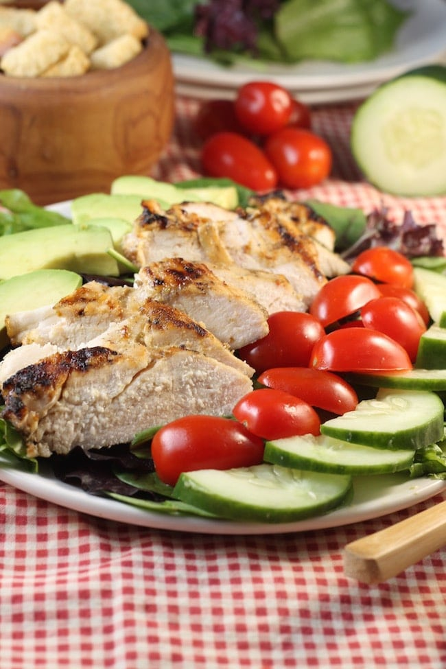 Grilled-Chicken-Salad-on-a-plate- with-tomatoes-cucumbers-avocados