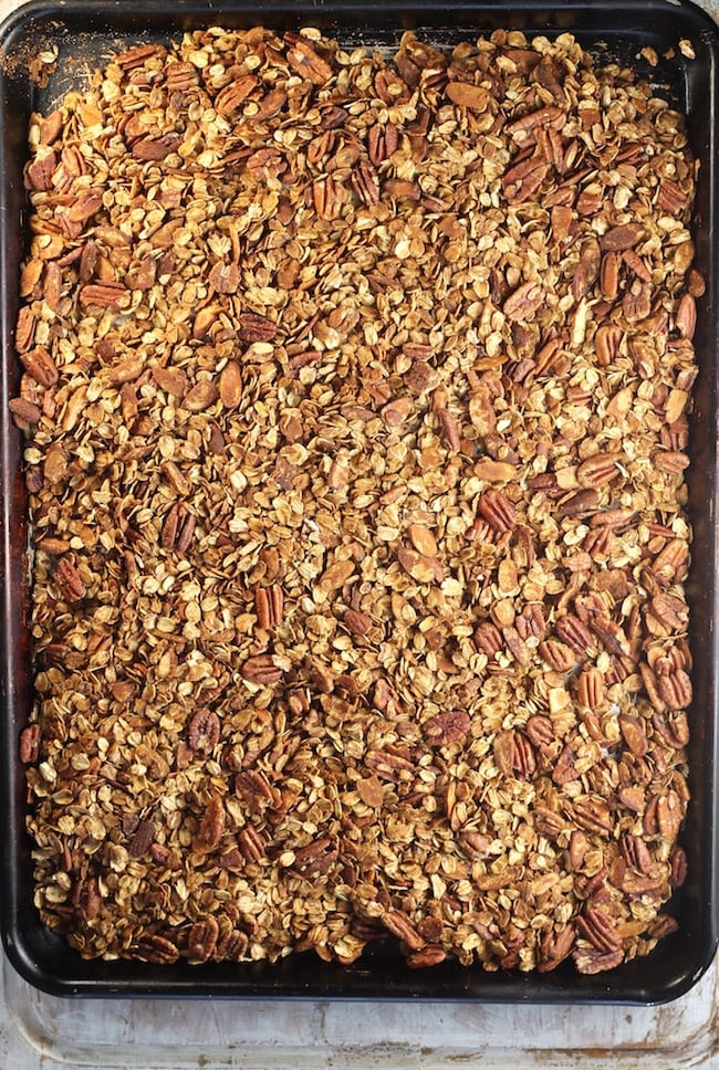 sheet pan of baked easy homemade granola with pecans and almonds