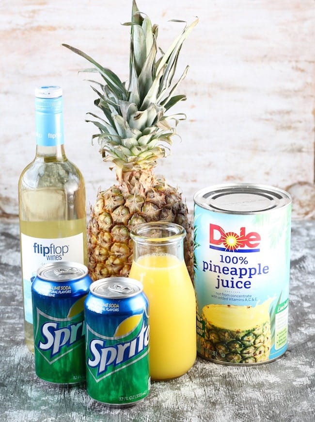 Ingredients for Easy Pineapple Wine Punch: Moscato Wine, Fresh whole Pineapple, Pineapple Juice, Orange juice and Sprite cans
