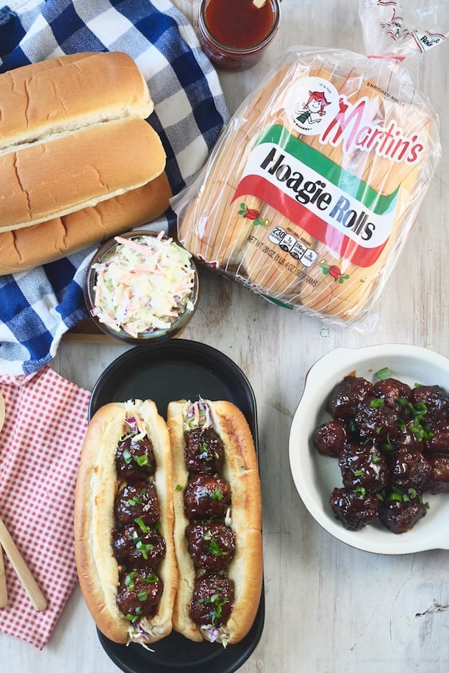 Barbecue Meatball Hoagies with Martin's Hoagie Rolls, bowl of coleslaw and barbecue meatballs in a shallow dish