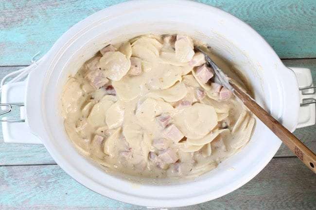Sliced potatoes and ham in slow cooker