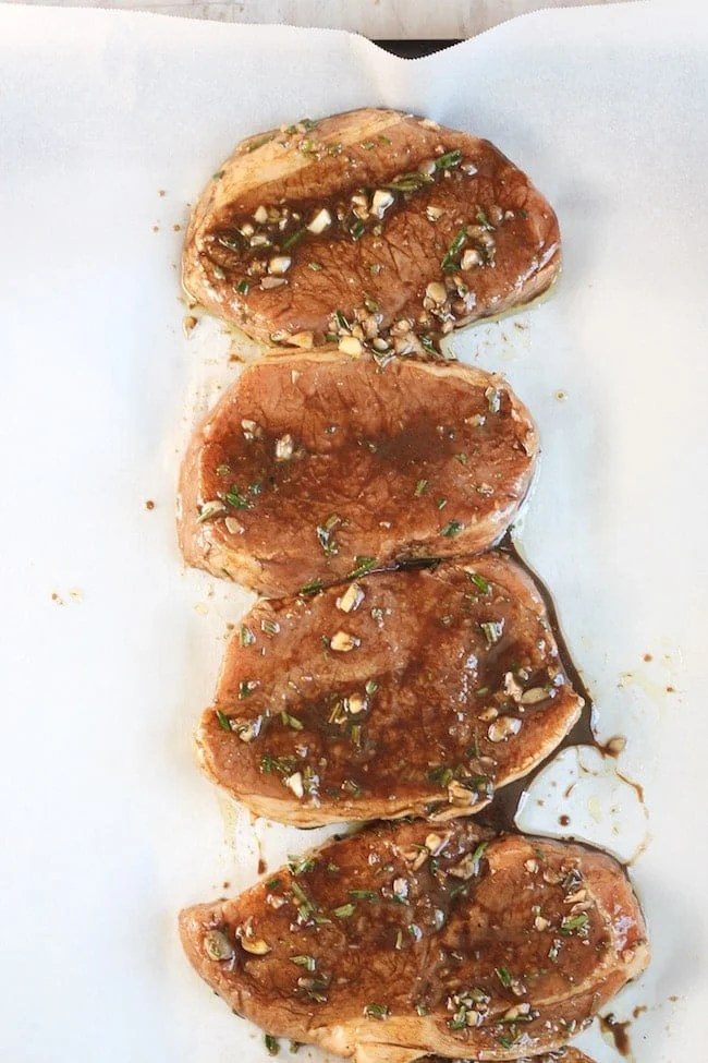 Balsamic Marinated Pork Chops on parchment paper