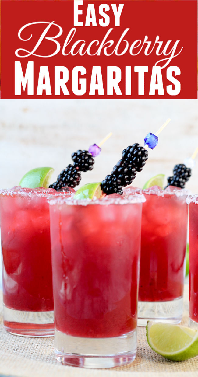 Easy Blackberry Margarita Party Cocktail garnished with fresh limes and blackberries