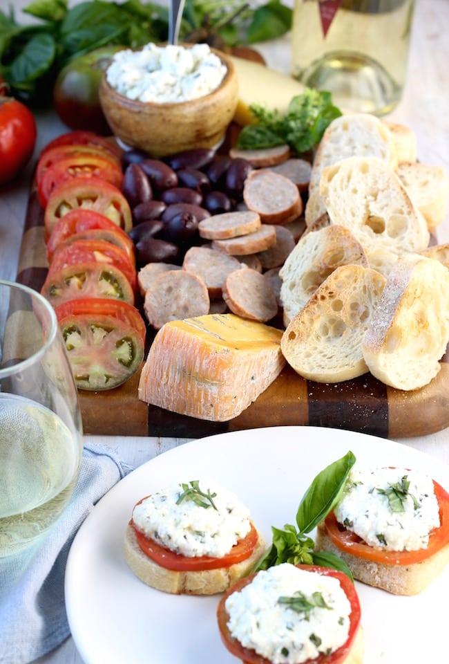 Tomato and Herbed Ricotta Bruschetta with wine and cheese