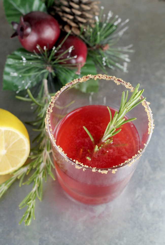 Pomegranate Sidecar Cocktail with bourbon and rosemary garnish