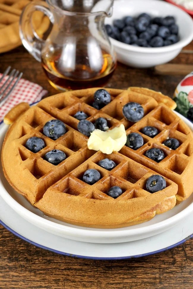 Easy Belgian Waffles topped with blueberries, butter and maple syrup