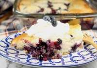 Easy Blueberry Cobbler served with sweetened whipped cream