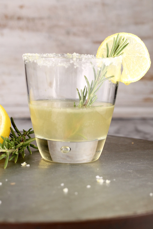 Sidecar Cocktail with bourbon served in an old fashioned glass, sugared rim, fresh rosemary and lemon garnish