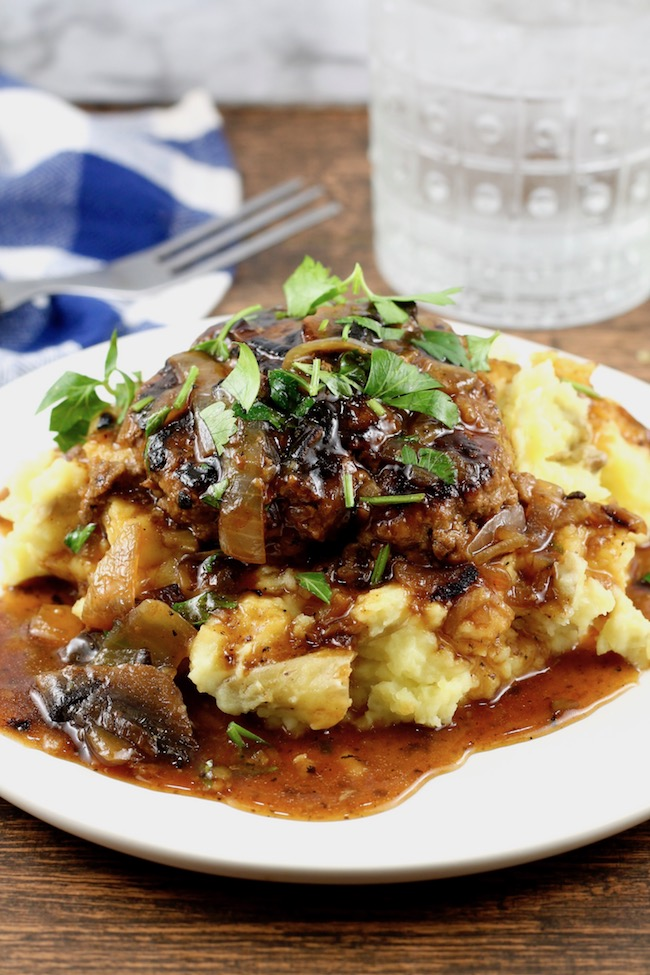 Easy Salisbury Steak with Onion and Mushroom Gravy over mashed potatoes.