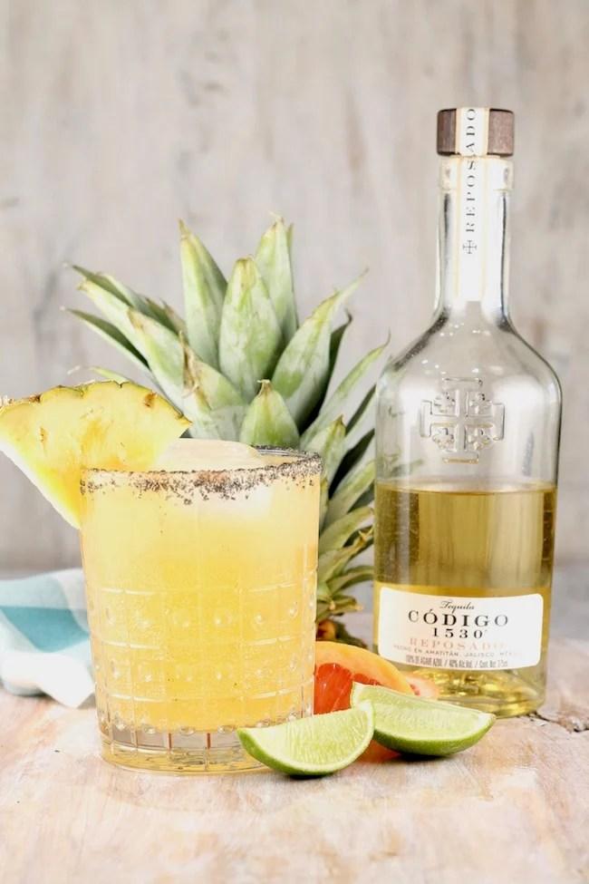 Codigo 1530 Reposado Tequila Pineapple Palmoa Cocktail garnished with fresh pineapple