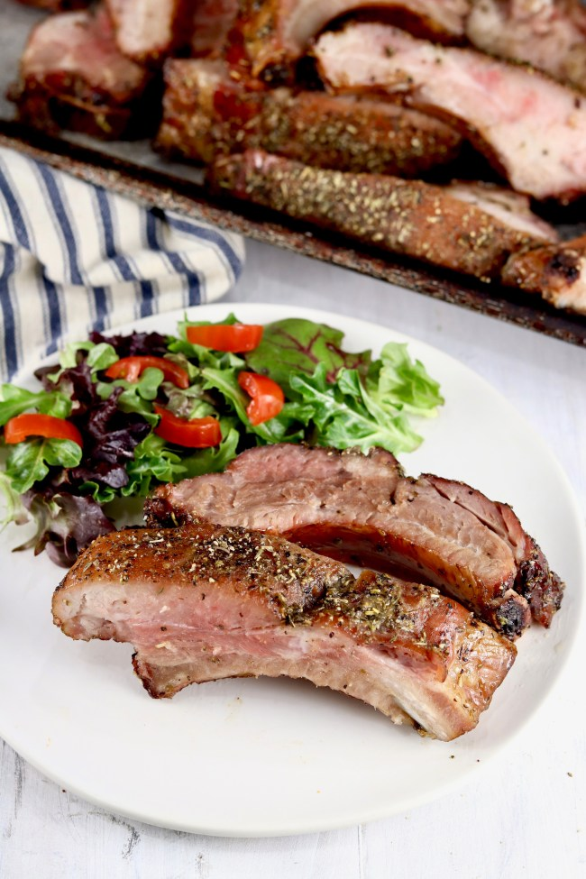Smoked Baby Back Ribs on a plate with green salad