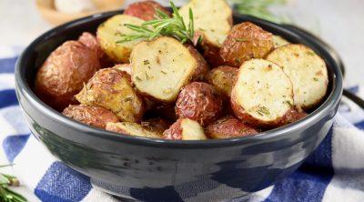 Roasted Red Potatoes with fresh rosemary garnish