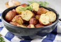Roasted Red Potatoes with fresh rosemary garnish