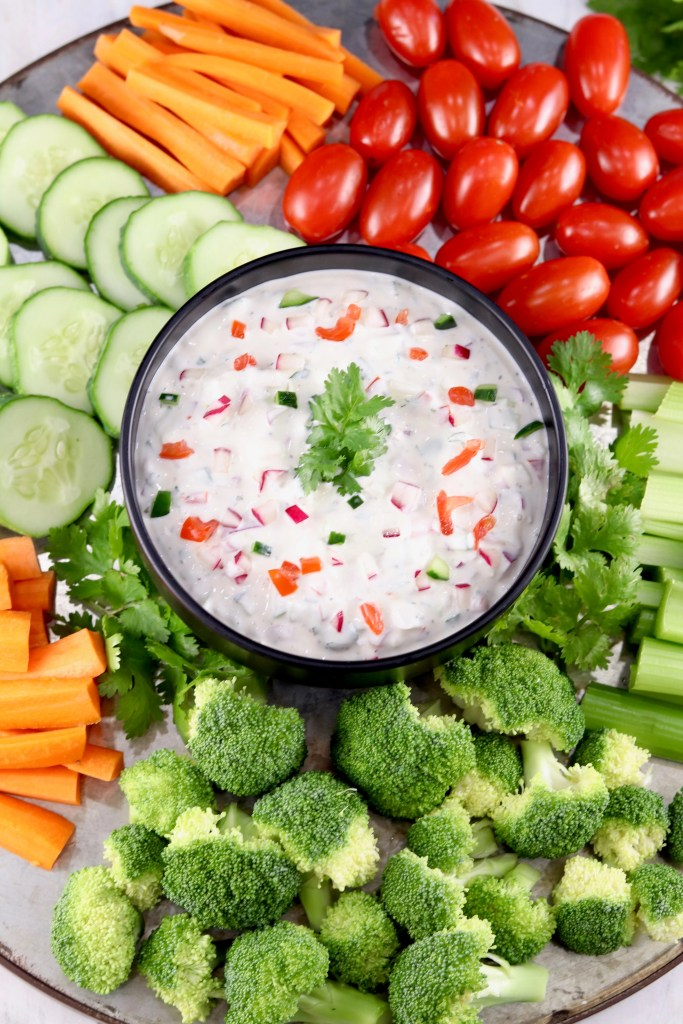 Summer vegetable tray with dip in center