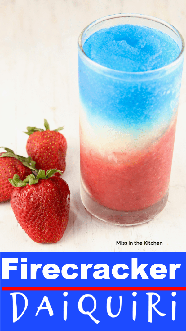 Layered frozen rum cocktail, red, white and blue daiquiri with fresh strawberries, text overlay on bottom
