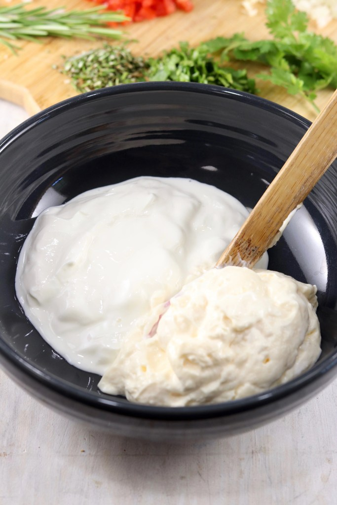Mayo and sour cream in a black bowl for dip