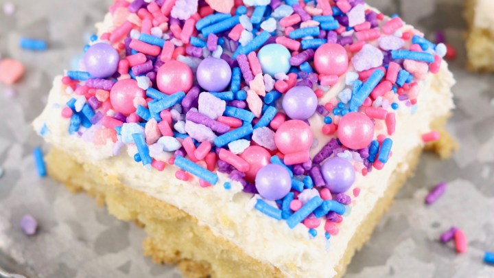 Overhead shot of cookie bars with pastel sprinkles