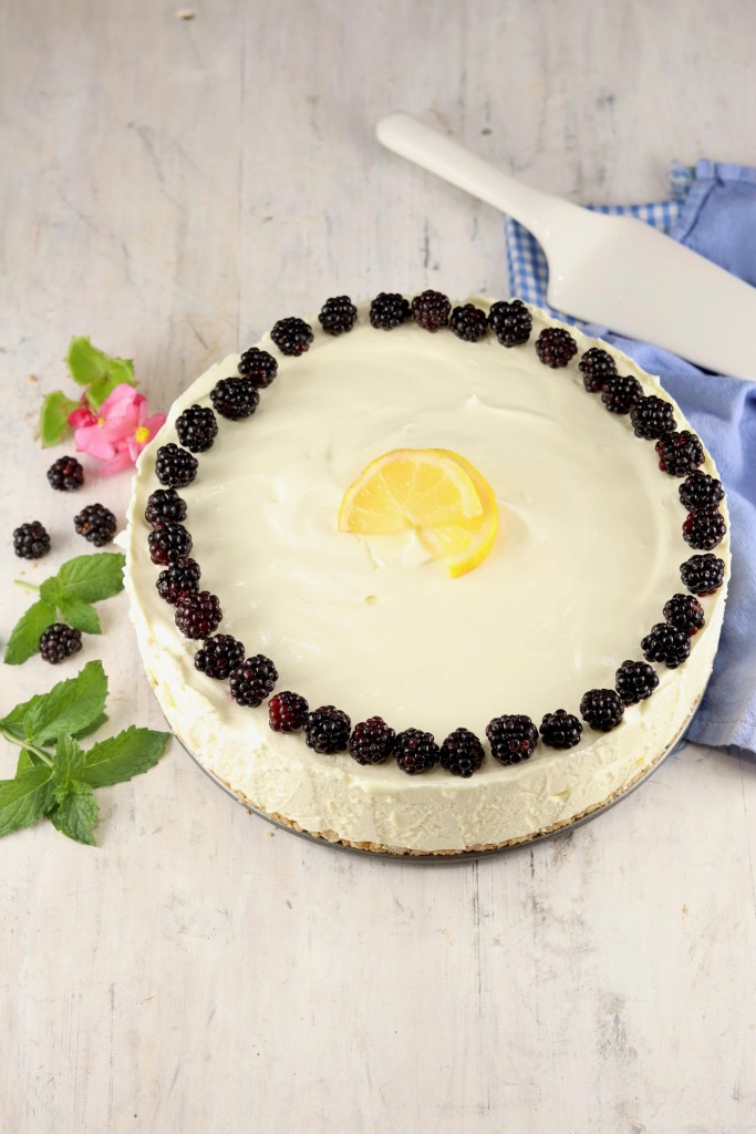 Lemon Chiffon made in a springform pan garnished with blackberries