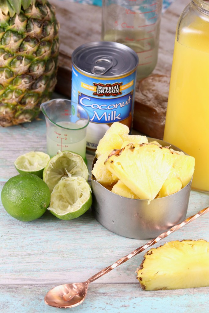 Ingredients for Pina Colada Mocktail with fresh pineapple, limes and coconut milk