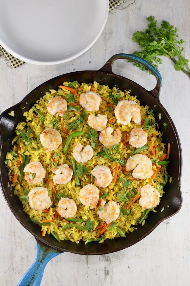 Cast iron skillet with fried rice with shrimp