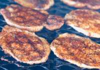 Boneless pork chops on grill with Cajun spices