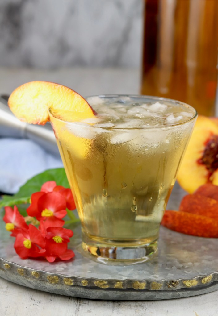 bourbon old fashioned cocktail with peach