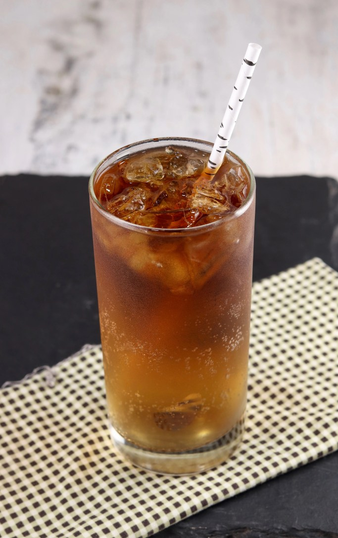 Rum and Ginger Cocktail with straw
