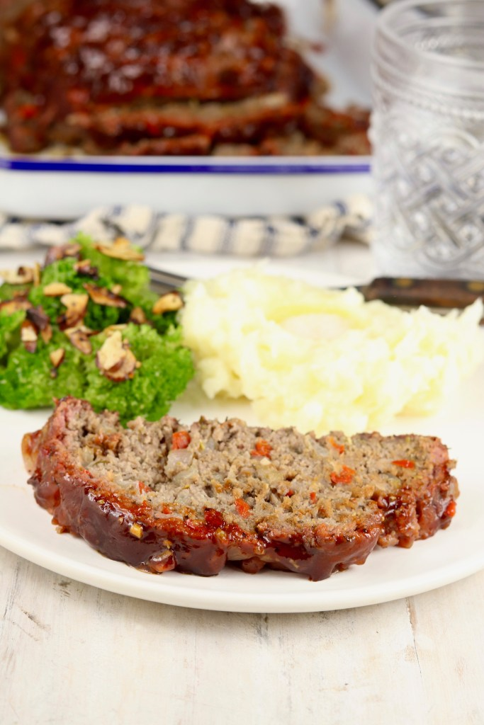 Plate of sliced meatloaf, broccoli and mashed potatoes