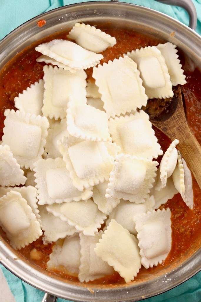 Cheese Ravioli in skillet with tomato sauce