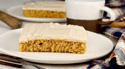 Slice of pumpkin cake and cup of coffee