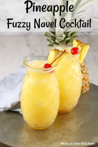 Text overlay pineapple fuzzy navel cocktail