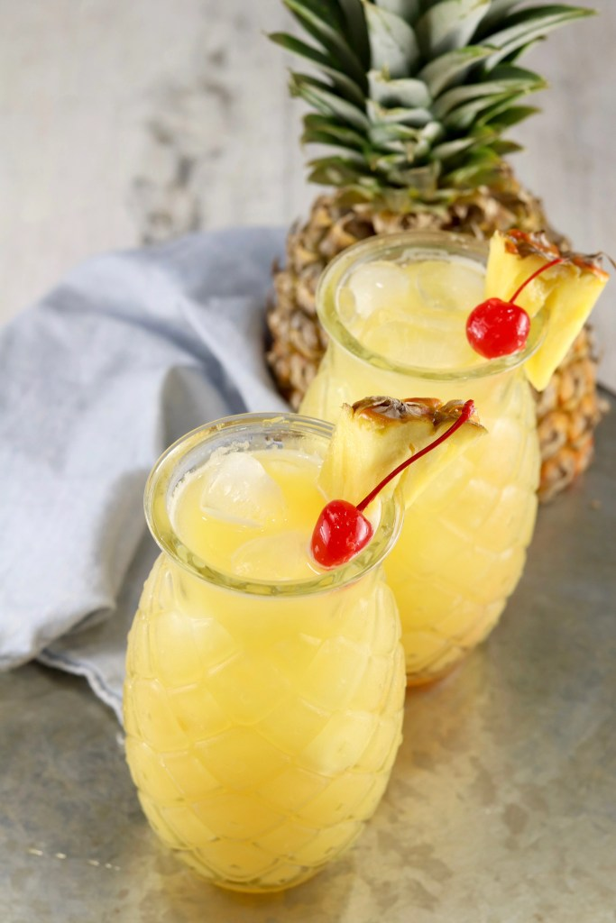 Fresh Pineapple with 2 pineapple glasses of peach and pineapple cocktail