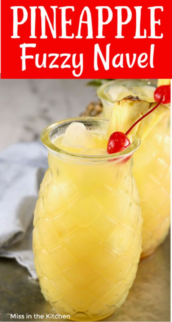 2 glasses of cocktails with pineapple and cherry garnish