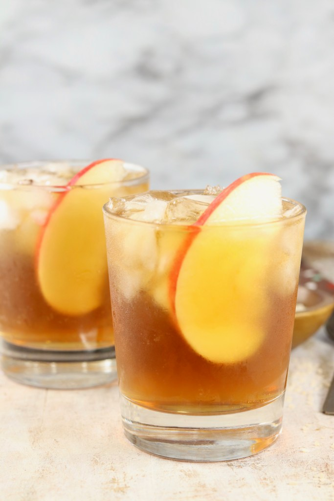 Apple Cider Cocktail with black rum and apple slice garnish