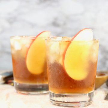 Spiked Apple Cider garnished with fresh apple slices