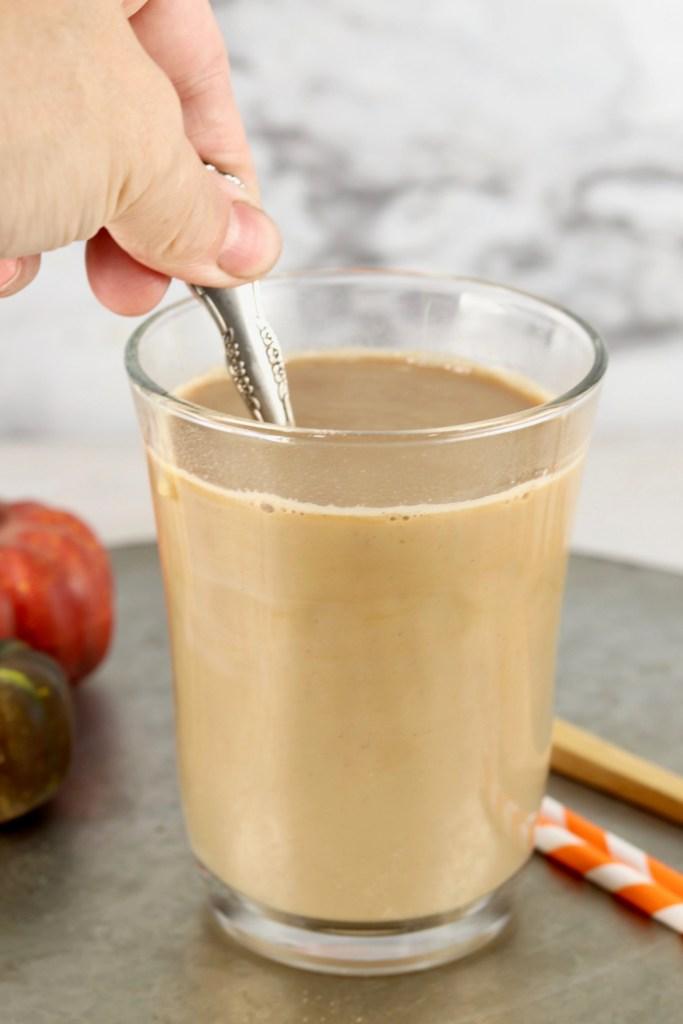 Stirring Chai Latte with Irish Cream and rum