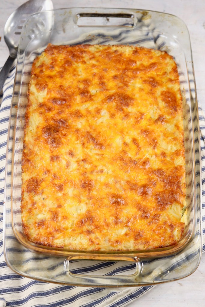 Baked potato casserole topped with cheese