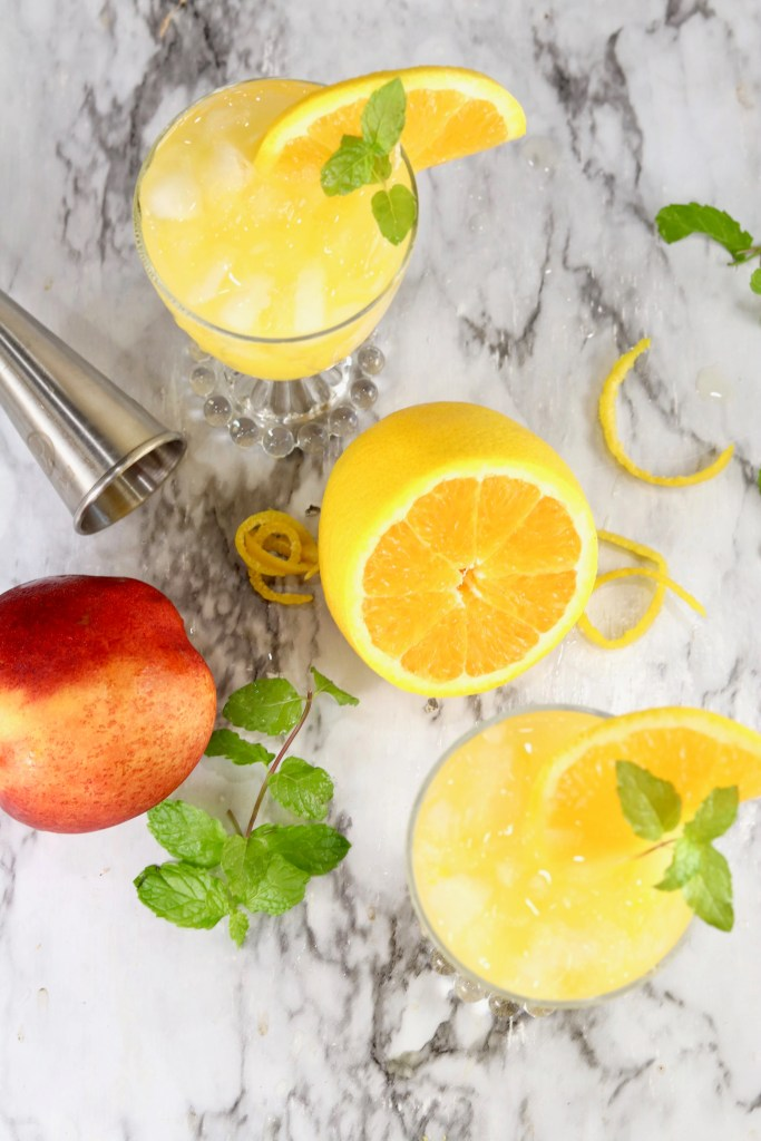 Fuzzy Navel Cocktail over head view with orange and peach