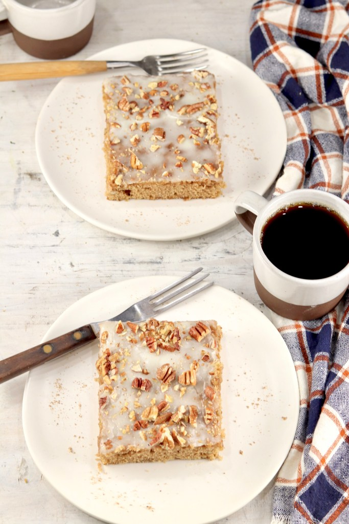 2 slices of pecan sheet cake with coffee