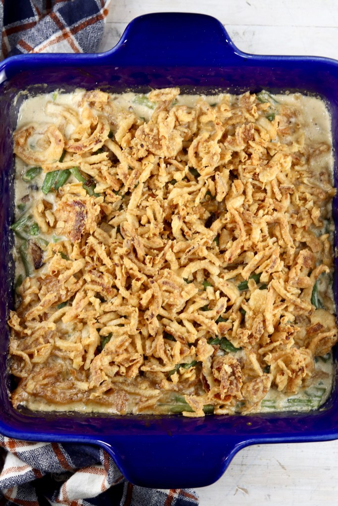 Blue casserole dish with green bean casserole