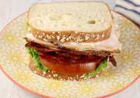 Turkey and bacon sandwich with lettuce and tomato