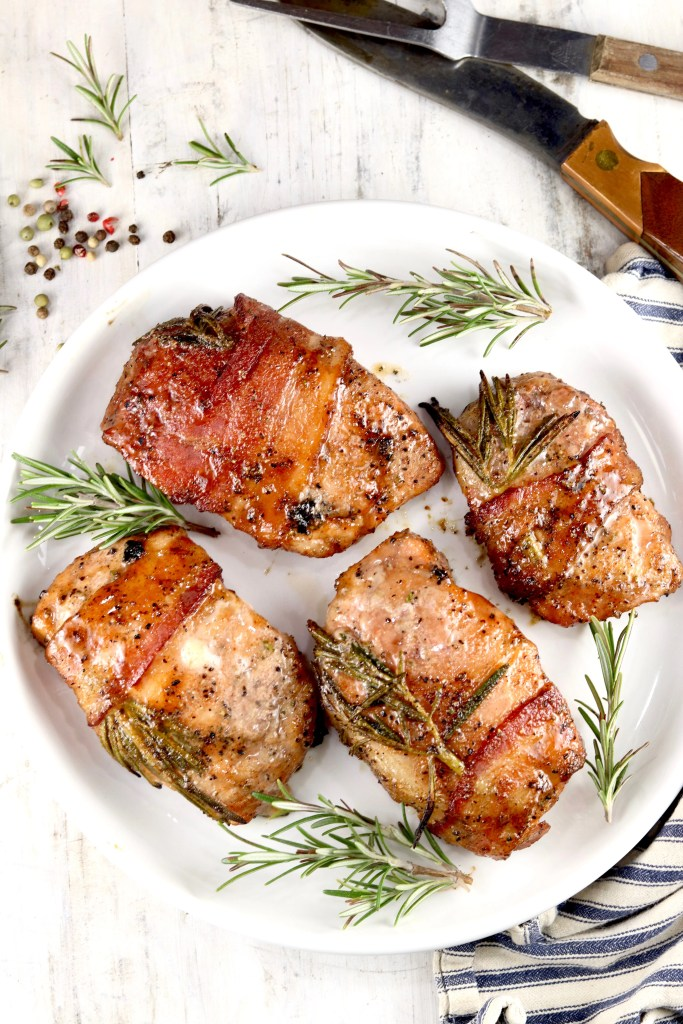 Grilled bacon wrapped maple and rosemary glazed pork chops