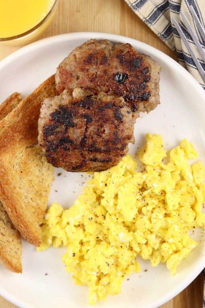 Breakfast sausage, scrambled eggs and toast