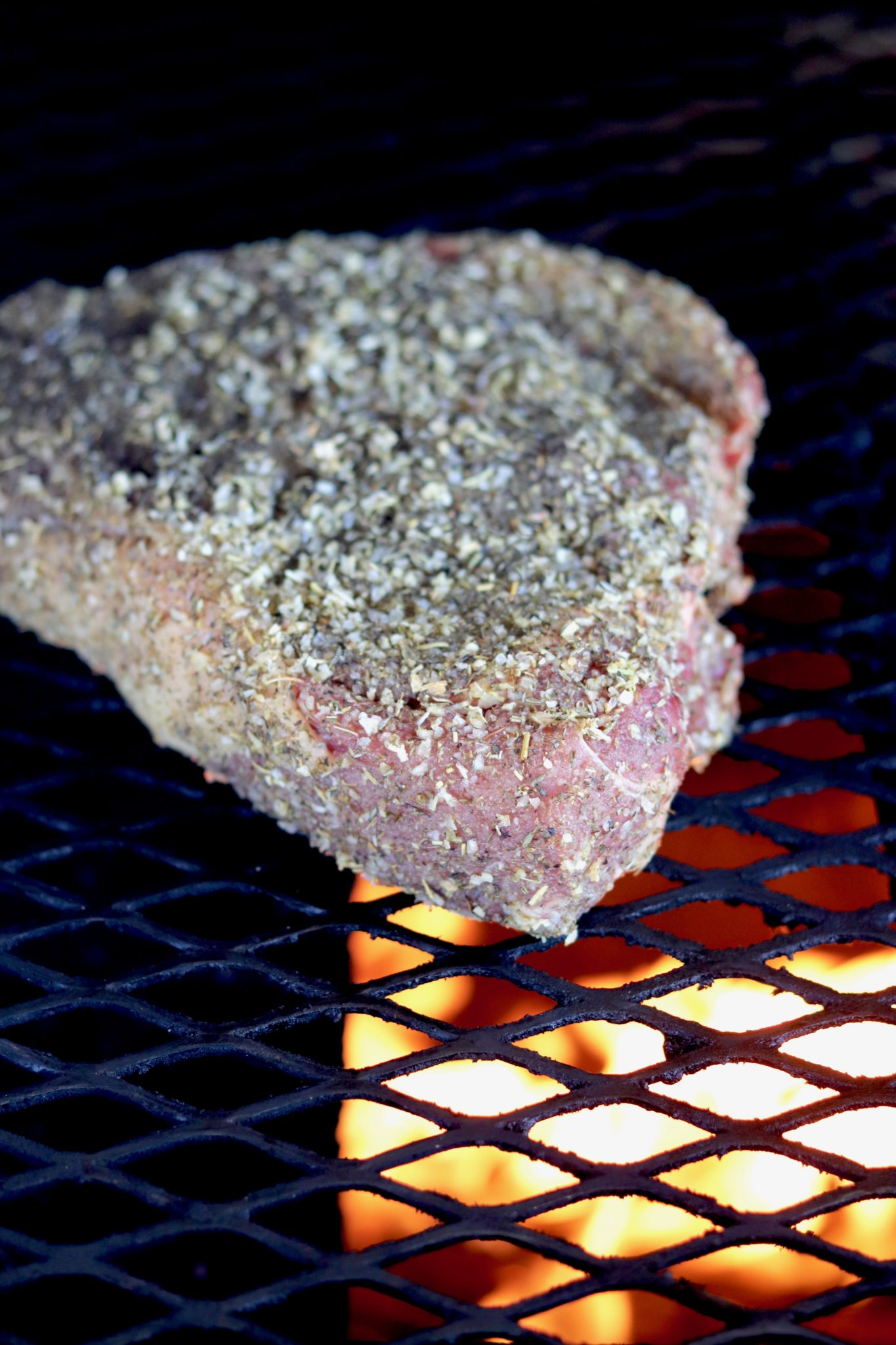 Roast on a grill with herb rub