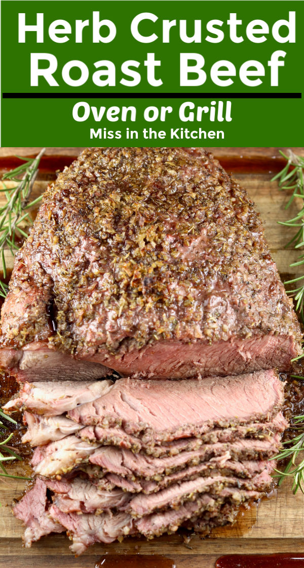 Herb Crusted Roast Beef - sliced on a cutting board